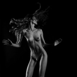 black and white photographs of naked slim woman with flowing hair