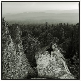 naked girl lying on a rock
