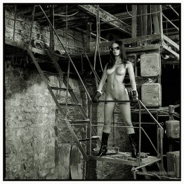 nudegirl in an old building with her glasses on