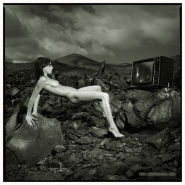 naked woman in a rocky environment